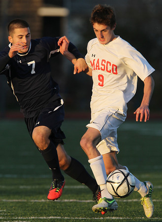 Masco junior Dylan Zernich, right, locks arms with St. John's Prep senior Tommy Buonopane, left, to try and shield the ball during the first half of play on Friday afternoon. The Eagles defeated the Chieftans 2-1 to advance to the D1 North Final on Sunday afternoon at Manning Field in Lynn and will square off with Sommerville. David Le/Staff Photo