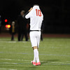 Masco senior Keyon Olia pulls his jersey over his face and slowly walks off the field following a 2-1 loss to St. John's Prep in the D1 North Semi-Final match on Friday afternoon. The Eagles will advance to face Sommerville in the North Final on Sunday afternoon at Manning Field in LYnn. David Le/Staff Photo