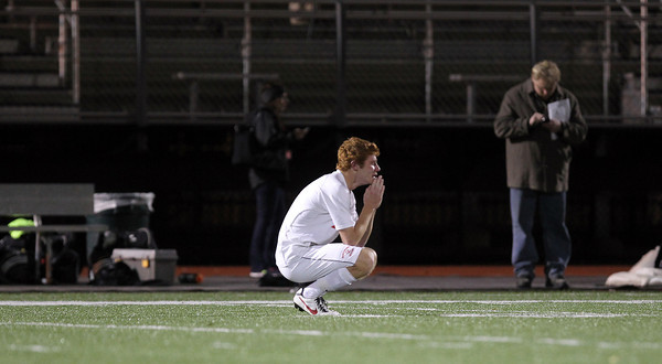 Masco senior Demetri DeCoulos can only kneel on Manning Field following a 2-1 loss to St. John's Prep in the D1 North Semi-Final on Friday afternoon. David Le/Staff Photo