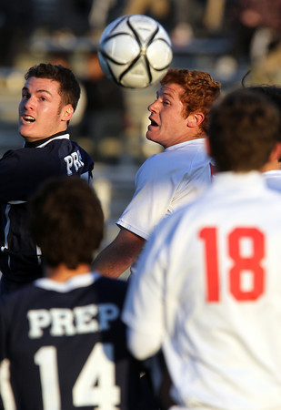 St. John's Prep senior Nate Schmidt, left, and Masco senior Demetri DeCoulos, right, watch as the ball deflects away on a corner kick in the first half of the D1 North Semi-Final at Manning Field in Lynn. David Le/Staff Photo