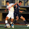 Masco senior Michael Ennis, left, and St. John's Prep Cory Lang, right, get tangled up as they fight for possession of the ball. David Le/Staff Photo