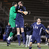 St. John's Prep senior keeper Ben Alpern, left, jumps in the air and celebrates with teammate Nathaniel Schmidt, center, and Cory Lang, right. Schmidt scored the Eagles' first goal and St. John's advanced to the D1 North Finals with a 2-1 victory over Masconomet on Friday afternoon. David Le/Staff Photo
