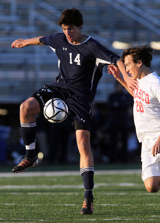 St. John's Prep junior Anthony Vigliotta, left, gains control of the ball while being pursued by Masco sophomore defender Daniel Raphael, right, during the first half of play. David Le/Staff Photo