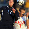 St. John's Prep senior midfielder Nate Schmidt, left, scores the first goal of the D1 North Semi-Final match off a header, beating Masco junior Adam Grammer, right, to the ball and dropping it into the back of the net. Schmidt and the Eagles prevailed 2-1 and advanced to the North Final on Sunday afternoon against Sommerville. David Le/Staff Photo