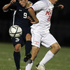St. John's Prep senior Levon Kazelyan, left, and Masconomet sophomore Daniel Raphael, right, collide as they battle for a loose ball in the second half of the D1 North Semi-Final match at Manning Field in Lynn. The Eagles defeated the Chieftans 2-1 to advance to the North Final on Sunday afternoon. David Le/Staff Photo