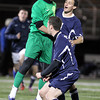 St. John's Prep senior keeper Ben Alpern, left, jumps in the air and celebrates with teammate Nate Schmidt, center, and Cory Lang, right. Schmidt scored the Eagles' first goal and St. John's advanced to the D1 North Finals with a 2-1 victory over Masconomet on Friday afternoon. David Le/Staff Photo