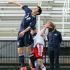 St. John's Prep senior midfielder Ernest Agresti, left, wins possession of the ball while leaping over Somerville's Marcelo Brociner, right, on Sunday afternoon. David Le/Staff Photo