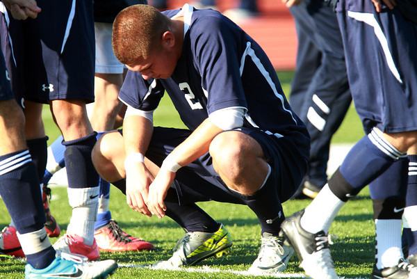 St. John's Prep senior Bruce Ocko kneels on Manning Field after a 1-0 loss to Somerville in the D1 North Finals. David Le/Staff Photo