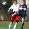 St. John's Prep senior Brooks Clark, right, reaches in to win the ball away from Somerville freshman midfielder Jonathan Argueta, left, during the second half of play on Sunday afternoon. The Eagles fell in the D1 North Final match to the Highlanders 1-0. David Le/Staff Photo