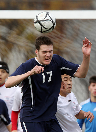 St. John's Prep senior midfielder Nate Schmidt wins a header off a corner kick on Sunday afternoon. The Eagles met Somerville in the D1 North Final, but eventually fell 1-0 to the Highlanders. David Le/Staff Photo