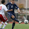 St. John's Prep senior Bruce Ocko boots the ball upfield while being pressured by Somerville's Thayrone Miranda, left, on Sunday afternoon in the first half of the D1 North Final. David Le/Staff Photo