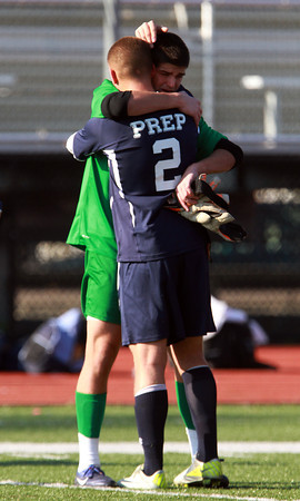 St. John's Prep seniors Ben Alpern, right, and Bruce Ocko, left, embrace after the Eagles fell to Somerville 1-0 in the D1 North Final on Sunday afternoon at Manning Field in Lynn. David Le/Staff Photo