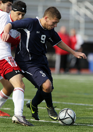 St. John's Prep senior striker Levon Kazelyn tries to control the ball against Somerville in the D1 North Final match at Manning Field in Lynn. The Eagles fell to the Highlanders 1-0 on Sunday afternoon. David Le/Staff Photo