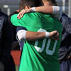 St. John's Prep senior goalie Ben Alpern buries his face in a teammate's shoulder following a 1-0 loss in a closely contested D1 North Final match against Somerville on Sunday afternoon at Manning Field in Lynn. David Le/Staff Photo