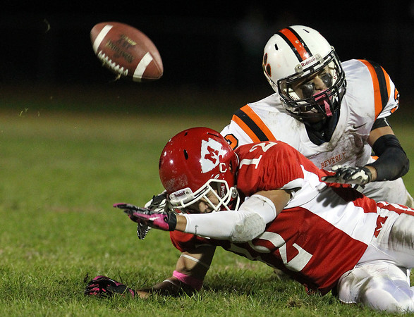 Beverly senior Ryan Shipp, right, breaks up a pass intended for Masco receiver Corey Tines, left, on Friday evening. David Le/Staff Photo