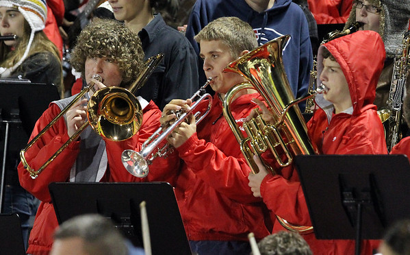Masconomet sophomores Andrew Neds, Nick Meixell, and Eric Blanchard, play along in time with the Masco fight song on Friday evening against Beverly. David Le/Staff Photo