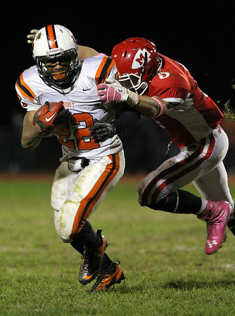 Beverly junior running back Isiah White shakes off Masco junior Mike McKay, right, during the 4th quarter of play on Friday night. David Le/Staff Photo