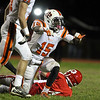 Beverly junior Sam Mulumba, left, celebrates a 4th down sack of Masconomet senior quarterback Chris Schleer, right, on Friday evening. David Le/Staff Photo