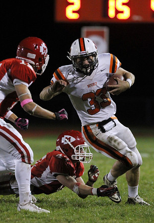 Beverly senior running back Brendan Flaherty, right, slips out of the tackle of Masco junior linebacker Mackenzie Cashin, center, and turns upfield. David Le/Staff Photo