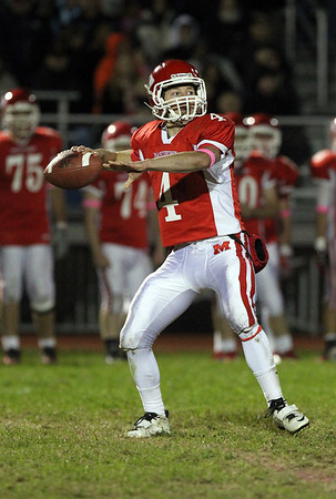 Masco senior quarterback Chris Schleer drops back to pass on Friday evening. David Le/Staff Photo