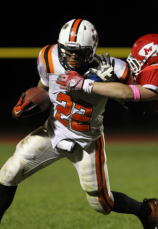 Beverly running back Isiah White shakes off a Masco defender during the 4th quarter of play on Friday night. David Le/Staff Photo