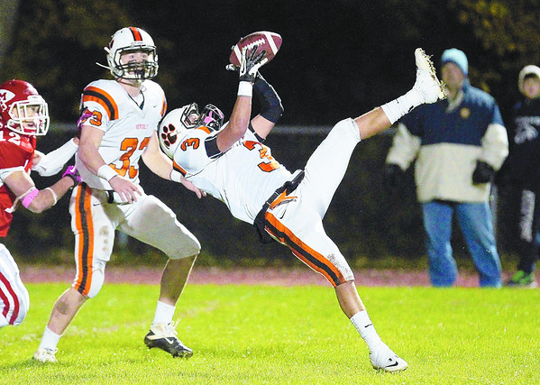 Beverly senior defensive back Ryan Shipp, right, comes down with the football after making a leaping intereption on Masco quarterback Chris Schleer, as teammate Brendan Flaherty, left, looks on. David Le/Staff Photo