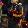 Beverly High School junior cheerleader Bri Dotson sports pink ribbons in her hair in support of Breast Cancer Awareness Month while she watches the Panthers defeat the Chieftans of Masconomet on Friday evening. David Le/Staff Photo