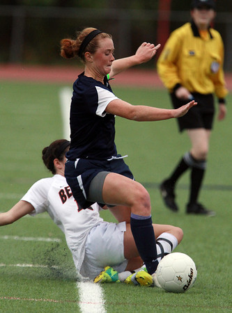 Swampsoctt's Erin Cassidy, right, gets taken down by Beverly's Kristen O'Connor, left, on Thursday afternoon. David Le/Staff Photo