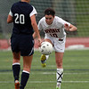 Beverly's Kristen O'Connor, right, kicks the ball past Swampscott's Melinda Wilson, left, on Thursday afternoon. David Le/Staff Photo