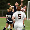 Swampscott's Erin Cassidy leaps high and wins a head ball against Beverly on Thursday afternoon. David Le/Staff Photo