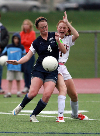 Beverly's Rose Terner, right, and Swampscott's Erin Cassidy, left, collide as they compete for a 50/50 ball on Thursday afternoon. David Le/Staff Photo