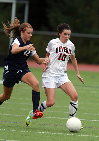 Beverly's Kristen O'Connor, right, controls the ball while being chased down by Swampscott's Mackenzie Robertson, left, on Thursday afternoon. David Le/Staff Photo