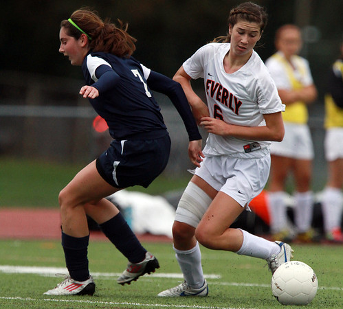 Beverly's Caitlin Harty, right, cuts back and gets past Swampscott defender Lauren Sullivan, left, on Thursday afternoon. David Le/Staff Photo