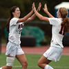 Beverly junior Caitlin Harty, left, gets a high five from senior Meggie Manzo after Harty scored the first and only goal in a 1-0 win for the Panthers over Swampscott. David Le/Staff Photo