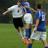 Danvers' Ryan Kelleher, right, wins a header over Beverly's Sean Curtis, left, on Tuesday afternoon. David Le/Staff Photo