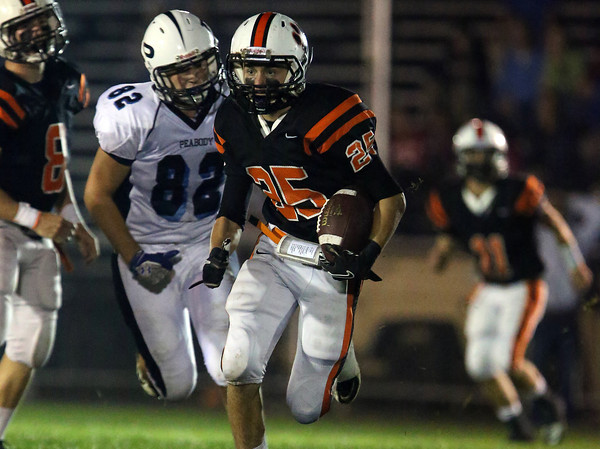 Beverly junior running back Joey Kozlowski breaks free against Peabody for a 33-yard touchdown run on Friday evening. David Le/Staff Photo