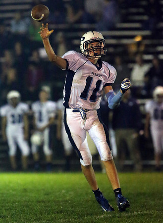 Peabody quarterback Michael Raymond releases a pass against Beverly on Friday evening. The Tanners couldn't get anything going and fell to the Panthers 49-0. David Le/Staff Photo