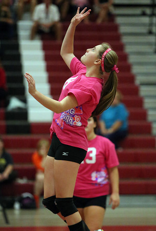 Salem High School senior Kayla Pellitier soars in the air and tips the ball over the net against Beverly on Friday afternoon. David Le/Staff Photo