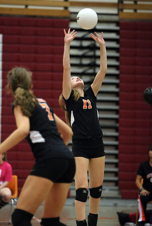 Beverly junior Hayley Finik sets the ball for a teammate against Salem on Friday afternoon. David Le/Staff Photo