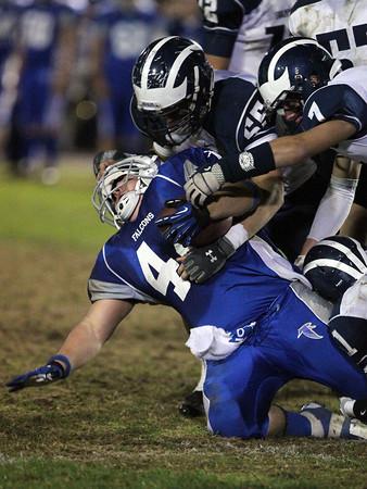 Danvers captain Alex Grant gets taken down by a few Swampscott defenders after a big gain.  David Le/Staff Photo