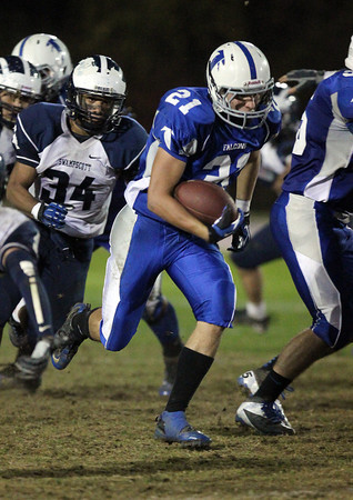 Danvers running back Alex Valles, breaks through a big hole against Swampscott on Friday night. Valles rushed for 162 yards and two scores to lead the Falcons to a 35-7 victory over the Big Blue on senior night.  David Le/Staff Photo
