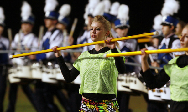 Danvers High School sophomore Kaitlyn Nash performs with the Color Guard during halftime of Friday night's game.  David Le/Staff Photo