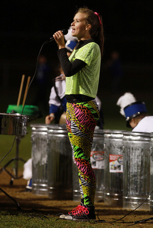 Danvers High School senior Ashley Brooks sings along in time with the Marching Band to a Black Eyed Peas song during the halftime show of Friday night's game.  David Le/Staff Photo