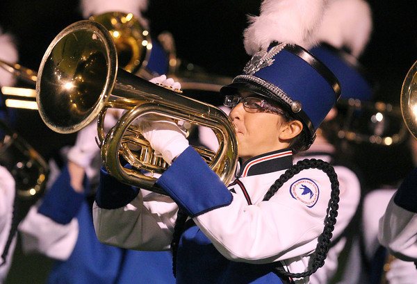 Danvers High School sophomore Raquel Leslie plays the school fight song after a Falcons touchdown on Friday evening.  David Le/Staff Photo