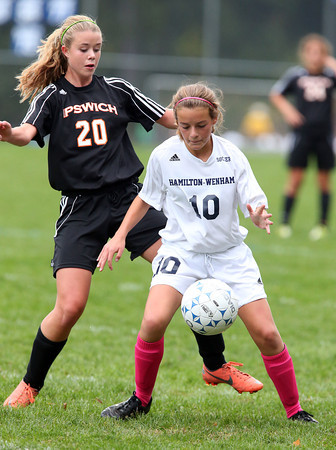 Hamilton-Wenham's Maddi Berthaud, right, controls the ball while being pressured by Ipswich's Joanna Perry, left, during the Generals 2-0 win over the Tigers on Tuesday afternoon. David Le/Staff Photo