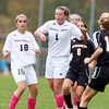 Hamilton-Wenham's Caroline Gribbell, center, wins a header against Ipswich on Tuesday. David Le/Staff Photo