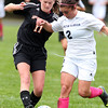 Hamilton-Wenham striker Alana Vecchiarello, right, and Ipswich's Emily Brengle, left, battle for a loose ball on Tuesday afternoon. David Le/Staff Photo