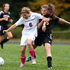 Hamilton-Wenham's Emma Durgin, left, tries to keep possession of the ball while being defended by Ipswich's Kristin Heffernan, right, on Tuesday afternoon. David Le/Staff Photo