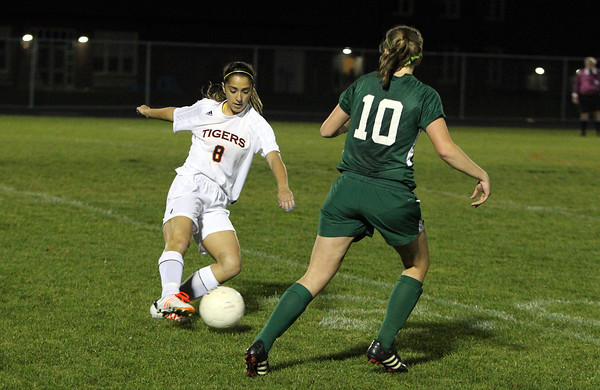Ipswich sophomore Natasha Vasiliades, left, plays the ball upfield while being pursued by Manchester-Essex sophomore Phebe Biggar, right, on Tuesday evening. David Le/Staff Photo
