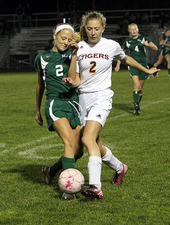 Manchester-Essex's Sarah Lewiecki, left, and Ipswich's Emily Evans, right, collide while battling for a loose ball on Tuesday evening.